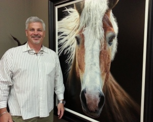 "artist Bruce K. Lawes with ""In the Wind"" painting"